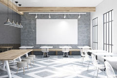 Cafe with tables, round chairs, big poster. Modern cafe interior with wooden walls and gray floor pattern, tables and round chairs near tall windows. Large Stock Photography