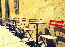 Cafe tables on a street Stock Photo