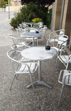 Cafe tables on street Stock Images