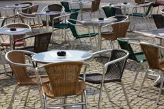 Cafe tables with wicker furniture. Setting cafe tables and wicker chairs Royalty Free Stock Images