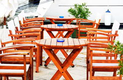 Cafe terrace on the seashore waiting for new customers. Stock Image