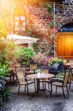 Cafe terrace in small European city Stock Photo