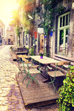 Cafe terrace in small European city royalty free stock images