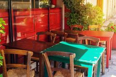 Cafe terrace in small European city on sunny summer day Stock Image