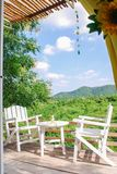 Cafe terrace with tables. And chairs and mountain Royalty Free Stock Photos
