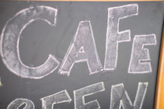 Cafe title written with chalk on blackboard Stock Photo
