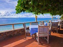 Cafe on tropical beach. Travel background Royalty Free Stock Images