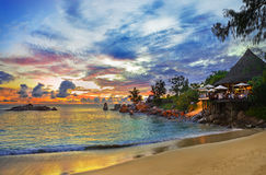 Cafe on tropical beach at sunset Royalty Free Stock Photography