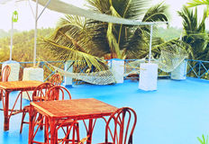 Cafe on veranda against  backdrop of tropical forest Stock Images