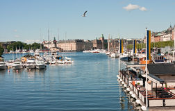 Cafe on the water. View on Strandvagen from the Djurgardsbron, Stockholm, Sweden Royalty Free Stock Image