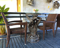 cafe with wicker chairs and table Royalty Free Stock Photo