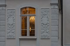Cafe window facade with lustre at evening. In historical city of south germany royalty free stock photos