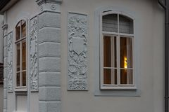 Cafe window facade with lustre at evening. In historical city of south germany stock photography