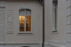 Cafe window facade with lustre at evening. In historical city of south germany stock photos