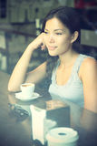 Cafe woman thinking Royalty Free Stock Image