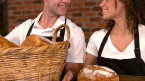 Cafe workers showing baskets of bread. In slow motion stock video footage