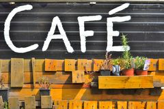 Cafe written on a black metal plate Royalty Free Stock Photos