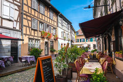 Cafes in Petite-France in Strasbourg. Strasbourg, France - August 09, 2014: Cafes in Petite-France in Strasbourg. Petite-France is an historic area in the Stock Image