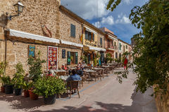 Cafes and restaurants in Alcudia's historic Old Town. Alcudia's cafes and restaurants in the historic centre get very busy in summer and in spring many tourists stock photography