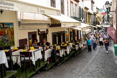 Cafes and Restaurants on Santa Maria Street in Funchal Madeira. This is a narrow street in the old town of Funchal. It is full of Restaurants and cafes, but is royalty free stock photos