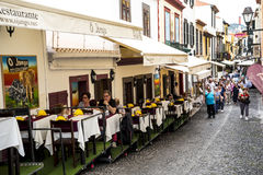 Cafes and Restaurants on Santa Maria Street in Funchal Madeira. This is a narrow street in the old town of Funchal. It is full of Restaurants and cafes, but is stock photography