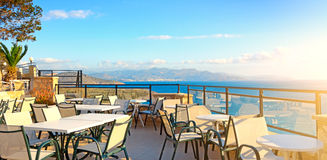 Cafes. Seascape. Greece Royalty Free Stock Images