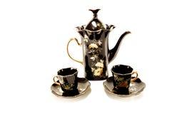 Cafeteira e dois copos de café Fotos de Stock