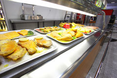 Cafeteria. Hot trays with cooked food on showcase at cafeteria Stock Photo