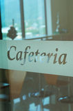 Cafeteria. Glass door with the word cafeteria on it royalty free stock photography