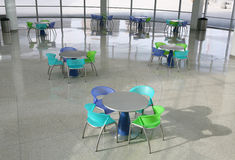 Cafeteria. A cafeteria interior inside a high tech office building with colorful chairs royalty free stock photo