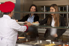 Cafeteria. Business women take lunch at cafeteria stock photography