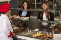 Cafeteria. Business women take lunch at cafeteria royalty free stock photos