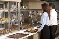 Cafeteria. Business women take cafeteria lunch Stock Image