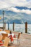 Cafeteria on the dock. Outdoor cafeteria in Riva del Garda by the Lake Garda, Italy royalty free stock photos