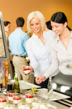Cafeteria food young woman choose dessert Stock Photo