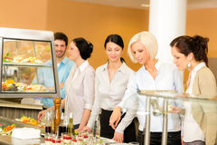 Cafeteria food young woman choose dessert Royalty Free Stock Images
