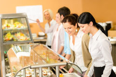Cafeteria lunch two office woman choose food Stock Photos