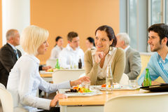 Cafeteria lunch young business people eat salad. At office canteen Royalty Free Stock Images