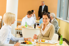 Cafeteria lunch young business women eat salad Stock Image