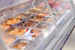 Cafeteria take-out food in showcase window Royalty Free Stock Images
