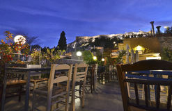Cafeteria on terrace Anafiotika Plaka Greece with Acropolis view Royalty Free Stock Photography