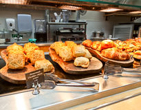 Cafeteria tray line. Cafeteria tray with homemade scones and croissants Stock Photography