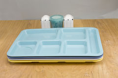 Cafeteria trays on wood table Royalty Free Stock Photography