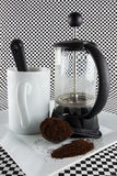 Cafetiere and cup Stock Photos