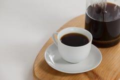 Cafetiere e um copo do café preto Foto de Stock Royalty Free