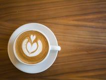 Caffè caldo con il fondo di arte del latte, concetto del fondo Fotografie Stock Libere da Diritti