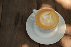 Caffè caldo di arte del cappuccino Immagini Stock