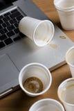 Caffè che è caduto sul computer portatile Immagine Stock Libera da Diritti
