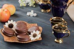 Caffè con i dolci e le mele Fotografia Stock