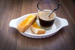 Caffè con pane tostato Fotografia Stock